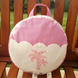 sac a dos enfant rose avec des palmiers